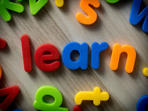 Learn concept. With toys on wood Stock Photography
