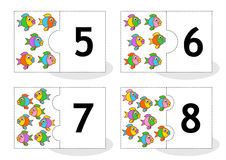 Learn counting puzzle cards with fish, numbers 5 - 8. Learn counting 2-part puzzle cards to cut out and play, fish themed, numbers 5 - 8 Stock Image