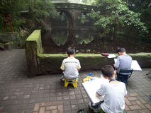 Learn drawing. Chinese kid learn drawing in park Royalty Free Stock Images