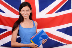 Learn English. Beautiful student holding books, blue blank book cover. Royalty Free Stock Images