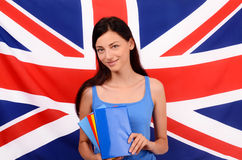 Learn English. Beautiful student holding books, blue blank book cover. Stock Photo