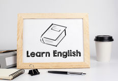 Learn English. Office table with wooden frame, space for text Royalty Free Stock Photos