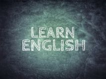 Learn English Text on blackboard Royalty Free Stock Image