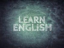 Learn English Text on blackboard. Learn english text writing on the blackboard Royalty Free Stock Image
