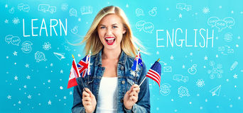 Learn English text with young woman. With flags of English speaking countries Royalty Free Stock Image