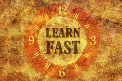 Learn fast. Text Learn Fast in the center of a circle on textured background Royalty Free Stock Images
