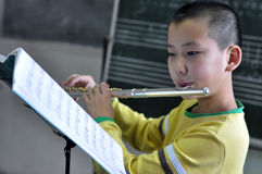 Learn the flute. Is very have accomplishment Royalty Free Stock Photo