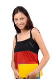 Learn German. Beautiful student with Germany flag blouse holding books. Royalty Free Stock Photography