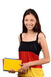 Learn German. Beautiful student with Germany flag blouse holding books. Royalty Free Stock Photo