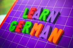 Learn german language alphabet on magnets letters.  royalty free stock images