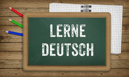 Learn German language, chalk on green board, education concept Royalty Free Stock Photos