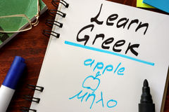 Learn greek written in a notepad. Stock Images