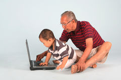 Learn How To Use a Laptop. Computer with grandpa Stock Image