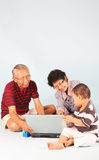 Learn How To Use a Laptop. Computer with grandpa & grandma Royalty Free Stock Images