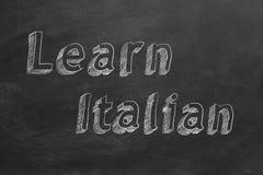 Learn Italian. Hand drawing `Learn Italian` on blackboard vector illustration