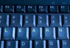 Learn keyboard. Clos up view of keys on keyboard spelling the word learn Royalty Free Stock Photo