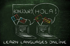 Learn languages online: laptop with different flags Stock Photo
