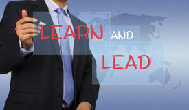 Learn and lead. Business man touching screen interface Stock Photography
