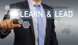 Learn and lead. Business man touching screen interface Royalty Free Stock Photos