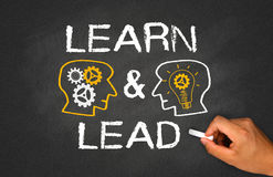 Learn and lead. Concept on chalkboard royalty free stock images