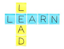 Learn-Lead Crossword. Made with sticky notes on white background Royalty Free Stock Photo