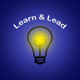 Learn and Lead - Leadership business concept. With blue background Stock Photography