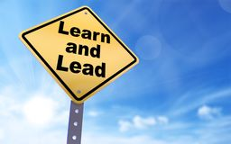Learn and lead sign. On blue sky background,3d rendered Stock Images