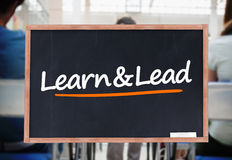 Learn and lead written on blackboard Royalty Free Stock Photo