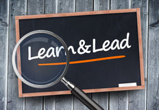 Learn and lead written on a blackboard Stock Photos