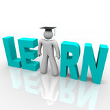 Learn - Man in Word with Graduation Cap Royalty Free Stock Photo
