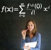 Learn math or maths teacher with chalk background. Learn Math or Maths confident beautiful woman teacher with pen and writing paper pad on chalk blackboard stock photo