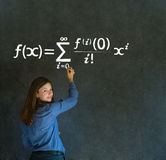 Learn math or maths teacher with chalk background. Learn Math or Maths confident beautiful woman teacher writing on chalk blackboard royalty free stock images