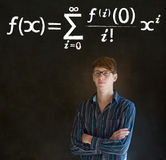 Learn math or maths teacher with chalk background. Learn Math or Maths confident handsome man teacher with arms folded and glasses chalk blackboard background stock photography
