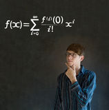 Learn math or maths teacher with chalk background. Learn Math or Maths confident handsome man teacher thinking with hand on chin and glasses chalk blackboard royalty free stock image