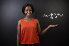 Learn math or maths teacher with chalk background. Learn Math or Maths South African or African American woman teacher or student chalk blackboard background stock photography