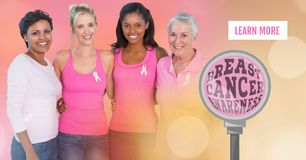 Learn more button with Breast cancer awareness magnified and women with transition. Digital composite of Learn more button with Breast cancer awareness magnified royalty free stock photo