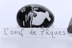 L`oeuf de Paques, French word on a white note for English Easter Egg. Learn new language, l`oeuf de Paques, French word for the English Easter egg written on a Royalty Free Stock Image