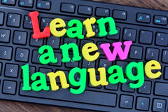 Learn a new language words on computer keyboard Royalty Free Stock Photos