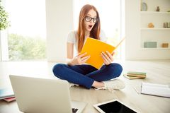 Learn notepad computer laptop people person concept. Smart cleve. R intelligent nerd geek silly facial expression lady teenager teen sitting on floor looking at stock photos