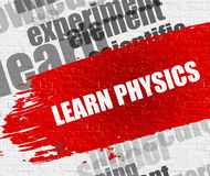Learn Physics on the White Brickwall. Stock Photo