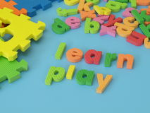 Learn and play. Colorful foam letters for play and learn Royalty Free Stock Images