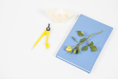 Learn and play. Discover and create. Book and flower, compasses and paper boat Stock Images