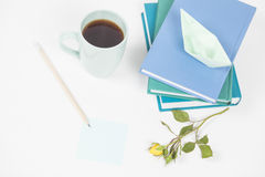 Learn and play. Discover and create. Coffee, books and pencil, paper boat, rose and post-it note Royalty Free Stock Photography