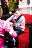 Learn play the guitar Royalty Free Stock Photo