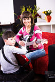 Learn play the guitar Royalty Free Stock Image