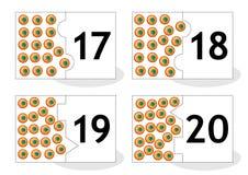 Learn que cuenta tarjetas del rompecabezas con la rana eggs, numera 17-20 Imagen de archivo
