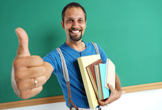 Learn it's cool! Joyful teacher showing thumbs up. Royalty Free Stock Photos