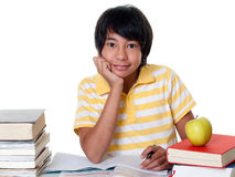 Learn for school. Young student make his homework against white background Stock Photo