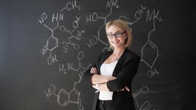 Learn science or chemistry formula confident beautiful woman teacher chalk blackboard background.  stock video footage