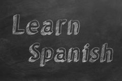Learn Spanish. Hand drawing `Learn Spanish` on blackboard vector illustration